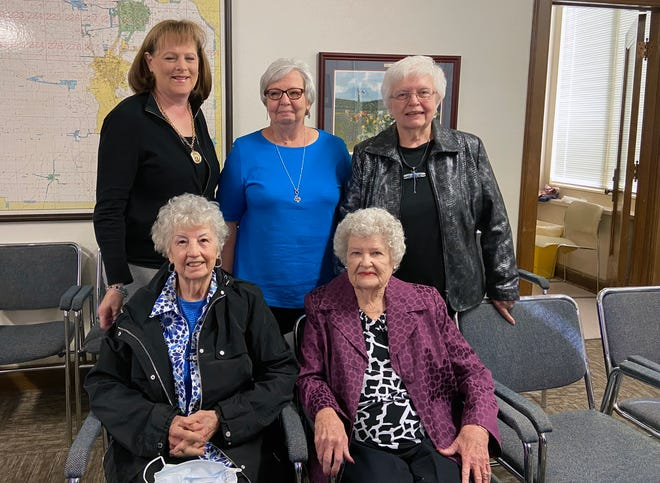 Texoma Exposition and Livestock Show volunteers who recently retired after decades of service were honored by county leaders Tuesday. Pictured from left to right seated are Mary Reed, Aurelia Holcomb, and standing behind them from left to right are Cathy Rains, Martha Mears, and Mary Nan Story.