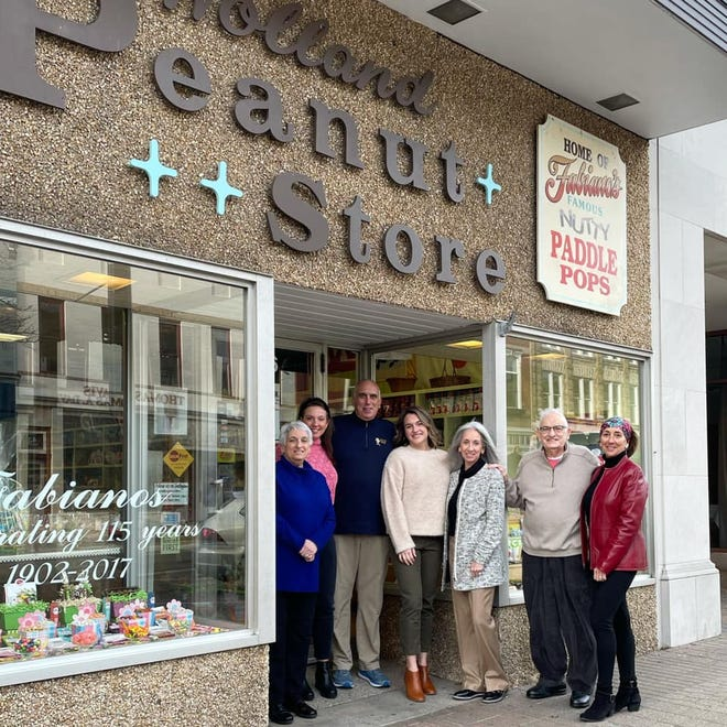 The Fabiano family poses for a photo outside Holland Peanut Store on Eighth Street in downtown Holland. The store's history will be featured in an upcoming fundraiser for Holland Museum.
