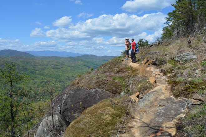 The view from the summit of the new Youngs Mountain Trail, which offers panoramic views of Lake Lure, Rumbling Bald, Weed Patch Mountain and the lower Hickory Nut Gorge. Conserving Carolina opened the 2.1-mile trail with a ribbon cutting Wednesday, April 21.