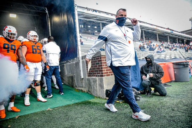 Illinois coach Bret Bielema leads his team onto the field before the Illini spring game Monday night in Champaign.