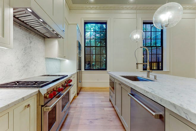 Contemporary expressions of affluence lie in the chef's kitchen, which takes center stage in the space as if ready for royal banquet preparation.