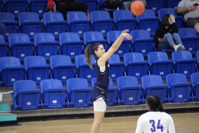 Otero's Emma Florez-Pascual, middle, attempts a 3-pointer over Syncere Harrod on Monday, April 19, 2021, at the Rip Griffin Center in Lubbock, Texas. Otero beat Butler 74-67 to advance to the second round of the NJCAA Women's National Tournament on Wednesday. [Charles Chaney/Gannett Kansas]