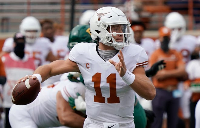 FILE - In this Oct. 24, 2020, file photo, Texas' Sam Ehlinger looks to pass against Baylor during the first half of an NCAA college football game in Austin, Texas.