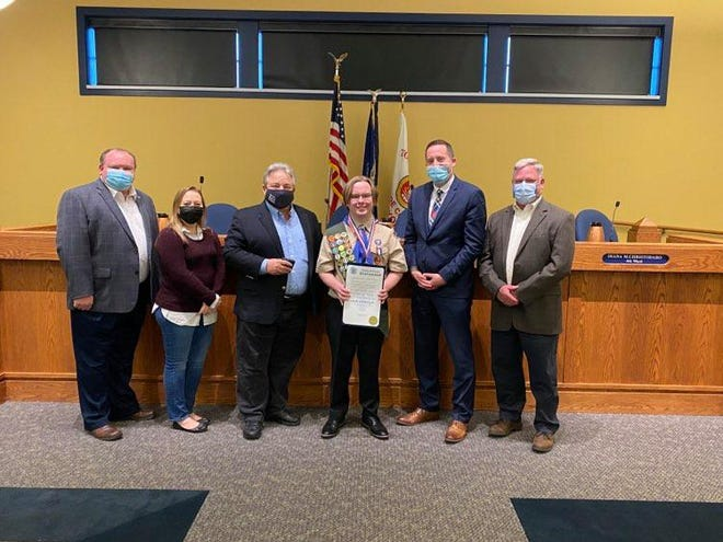 Supervisor Bill Reilich and Greece Town Board members Mike Barry, Mike Bloomer, Diana Christodaro and Bill Murphy present the Eagle Scout Recognition Medal to Nick Novellin, of Troop 48, who achieved the rank after producing and donating over 500 cloth masks to the Golisano Children's Hospital.