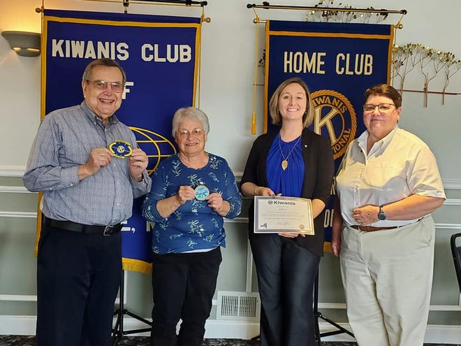 Marie Schoenacker, past lieutenant governor of the Kiwanis NY District, Genesee Division, presents a 2019-20 Distinguished Club Award to the Kiwanis Club of Greece. The club was recognized for its growth in membership, participation in the Governor's Project  (mental health awareness) and First Lady's Project (baskets for homeless children in the Greece Central School District), and contribution to the Kiwanis Children's Fund. Past President Heather Henderson received a Distinguished President pin and Vivien Terry received a Distinguished Secretary pin. Pictured, from left, are President Jon Kuppinger, Terry, Henderson and Schoenacker.