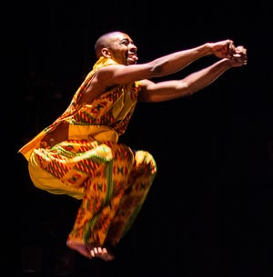 A dancer jumps for joy in anticipation of this year's Sankofa African Dance and Drum Ensemble concerts, streaming May 1-22.