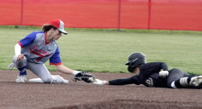 Spartans starting second baseman Braedan Hunt just misses placing the tag on Cairo runner Hayden Holman on time as Holman ends up stealing the bag in the top of the fourth inning Monday. Holman, the No. 9 batter in the Bearcats lineup, went 2-4 with a RBI to help Cairo defeat Moberly 8-1.