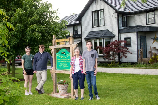 The Benjamin and Anna Niedermeier Farm is a Michigan Centennial Farm. Shown here are Mary Brown Beaubien (second from right) and her grandchildren, Meghan Beaubien (far left), Matthew Beaubien (second from left) and Roman Beaubien (far right). All are descendants of Benjamin and Anna Niedermeier.