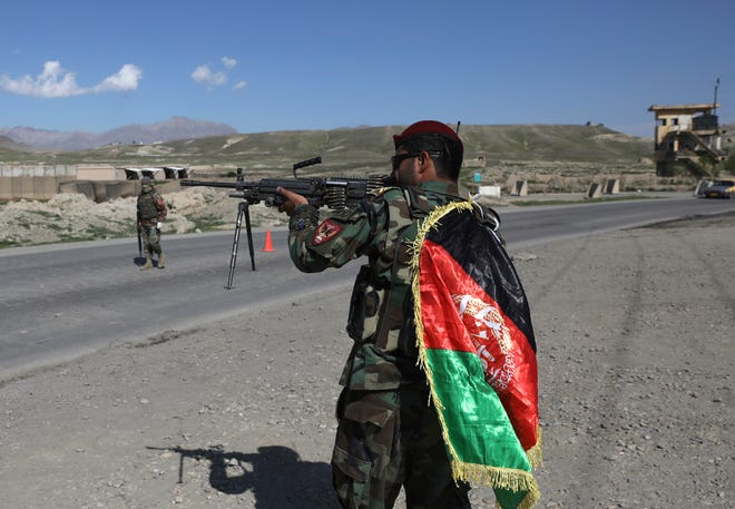 Afghan National Army soldiers stand guard recently at a checkpoint on the outskirts of Kabul, Afghanistan. The U.S. military  has begun shipping out equipping in preparation for its troop withdrawal on Sept. 11.