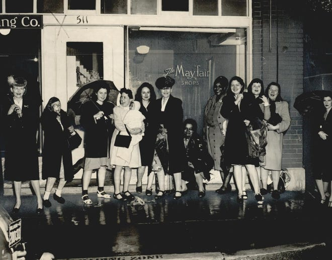 """A line forms outside The Mayfair Shops as women wait for the doors to open, anticipating the opportunity of buying nylon hosiery, which had been scarce during World War II. The Mayfair Shops were at 511 N Hudson in downtown Oklahoma City. This photo was published in April 1946 in the Oklahoma City Times. A February 1947 advertisement in The Daily Oklahoman read, """"The Mayfair Shops brought nylon hose to you during a trying time, and sold them without discrimination. They are again open for business and ready to serve you with the same fine quality, full-fashioned hose."""" By March 1947, another advertisement announced the business was closing and selling nylons at discounted prices."""