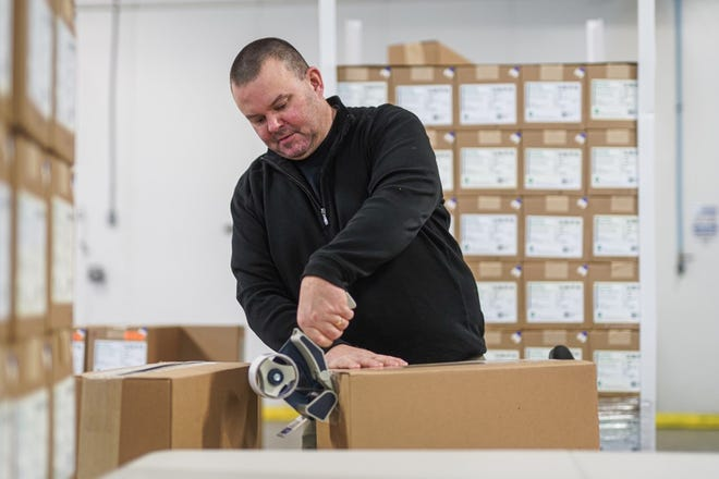 An employee is seen busy at work at Volk Packaging Corporation, a Biddeford-based business that recently announced plans to expand into Sanford.
