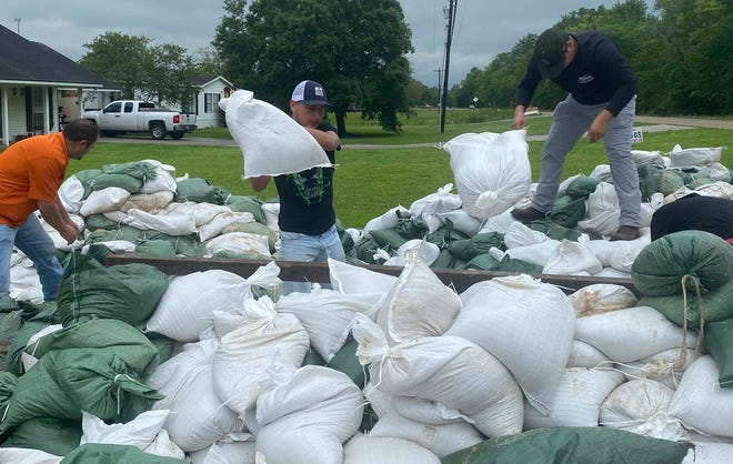 Residents stocked up on sandbags Saturday at Bayou Pigeon Fire Department, one of the sites throughout the parish that offered the bags as relief from flooding.
