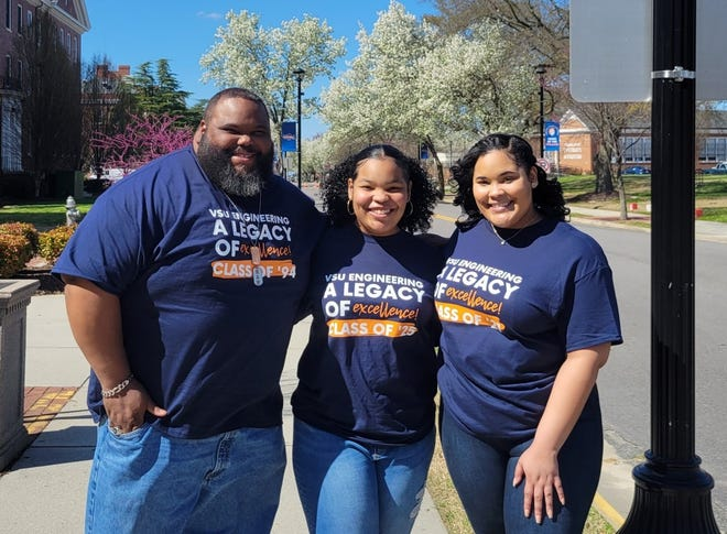 From left to right, Pastor Lewis L. Tucker Jr. with his daughters Kourtney and Kyah at Virginia State University.
