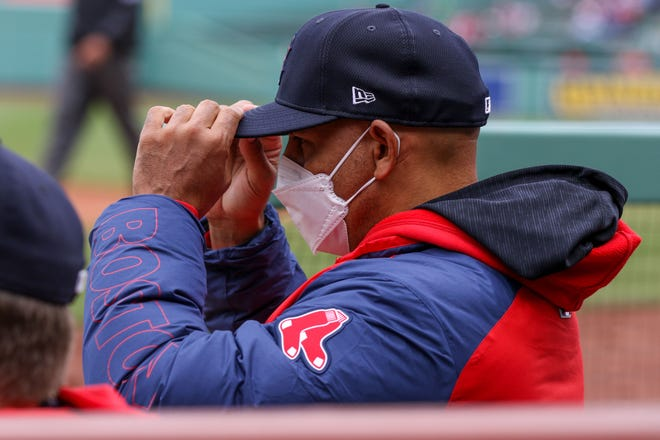 Alex Cora, shown in an April 7 game against Tampa Bay, nearly missed Tuesday's series opener as he awaited final clearance of COVID-19 protocols.