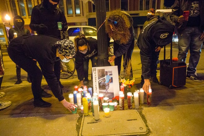 Protesters hold a vigil near Rockford City Hall on Friday for men and women killed by law enforcement. Rockford police and city leaders say they're preparing for potential unrest following the verdict in the Derek Chauvin murder trial in Minnesota.