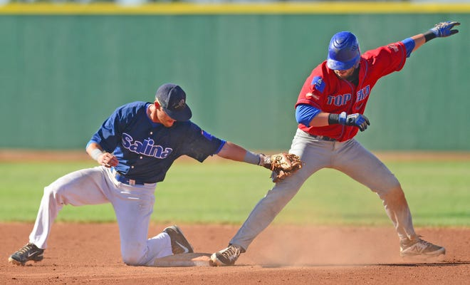 Salina Stockade shortstop Morgan Blatnik stretches to tag a Topeka Train Robbers runner at second base in a June 2016 game at Dean Evans Stadium. The Stockade will return to Salina for 13 home games this summer.