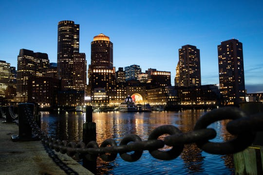 The Boston skyline, March 30, 2021. Suburban homeowners who have profited from the urban exodus during the pandemic are leaving small-town life behind to find out what they have been missing. (Kayan Szymczak/The New York Times)