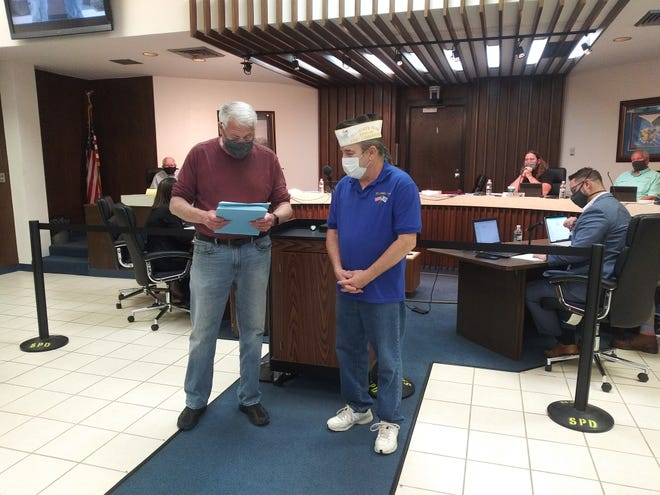 Mayor Ed Bolt reads a proclamation for Loyalty Day, as Shawnee Veterans of Foreign War (VFW) Post 1317 Honor Guard Commander Don Plumley listens during Shawnee City Commission Monday night.