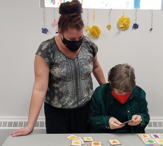Selina Hartweg, left, development training instructor for Abilities Plus, works with Community Day Services participant Diane Lahr. Several recent retirements from Abilities Plus has led the organization to focus on recruiting new talent.