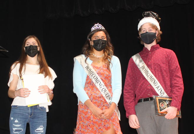 Homecoming King Henry Burkhart wasn't officially crowned at the ceremony because he was out due to COVID-19 protocols. To help rectify that, KHS Student Council President Hannah Pratt, left, at Monday's board meeting crowned Burkhart and Homecoming Queen Ailynn Duarte, making the court official.