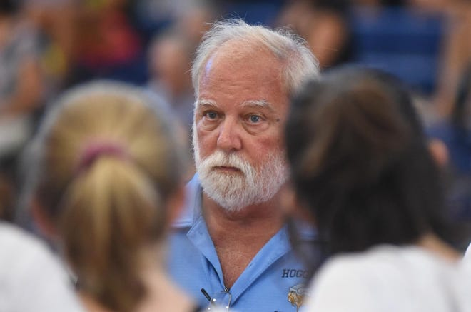 Hoggard volleyball coach Ron Strickland talks with his team during the match against Ashley at Hoggard in Wilmington, N.C., Tuesday, September 4, 2018.