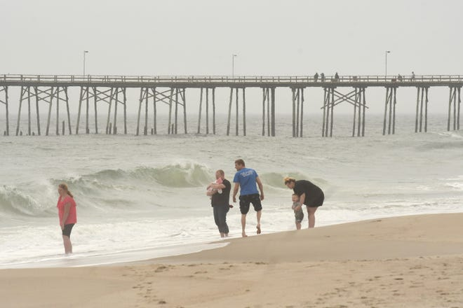 A Raleigh man died after becoming distressed while swimming at Kure Beach Thursday.