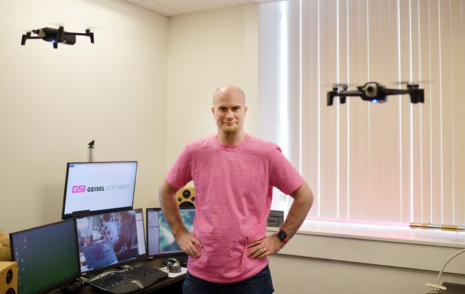 Brian Geisel of Geisel Software, which was recently awarded a contract with NASA, with Parrot drones in his office at the Worcester Business Center last week.