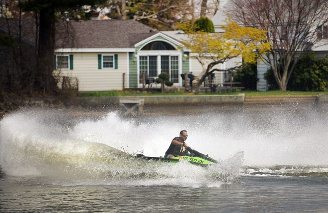 Raul Urbina of Rutland enjoys an afternoon on Indian Lake with his jet ski last month in Worcester.