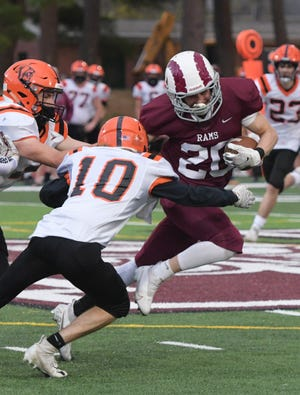 Northbridge's Rocco MacNeil, right, avoids a tackle from Uxbridge's Lucas Volpe during Monday's game.