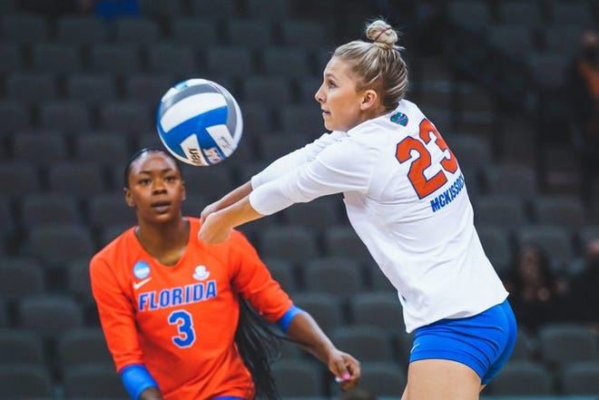 Elli McKissock makes a dig for Florida while teammate T'ara Ceaser looks on.
