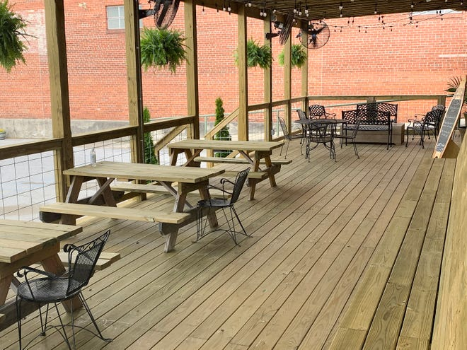 Outdoor diners can get plenty of ventilation and can spread out and socially distance on Back Forty Beer Co.'s new porch.