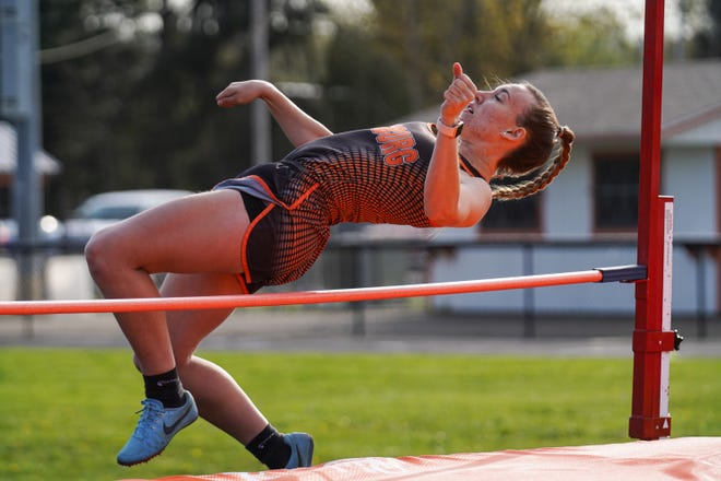 Strasburg's Allie Bitikofer inches over in the girls high jump.
