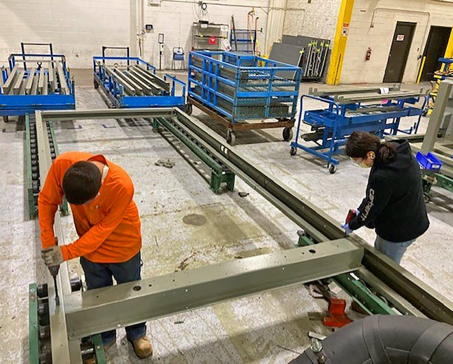 Trane workers begin the assembly of a large unit at the company's commercial heating, ventilating and air-conditioning manufacturing plant in Pueblo.