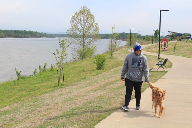 Mat Portillo, 29, of Fort Smith walks his dog at Riverfront Park Tuesday, April 20, 2021 in Fort Smith.