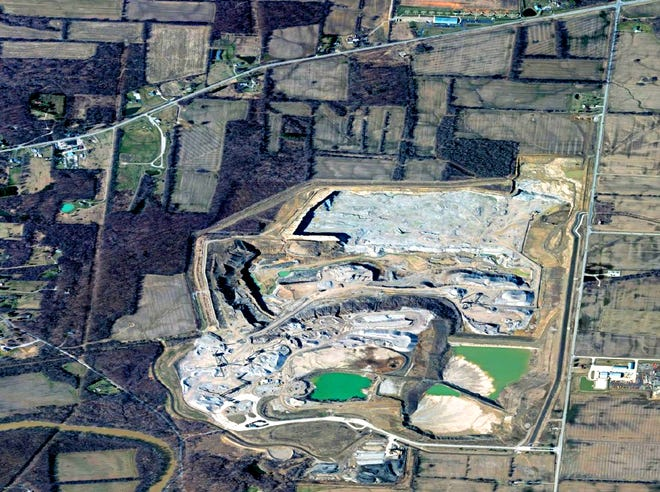 This aerial photo shows the National Lime & Stone Co. quarry at 2406 S. Section Line Road. U.S. Route 36 runs from left to right at the top of the photo. Section Line Road runs down the photo at the right.