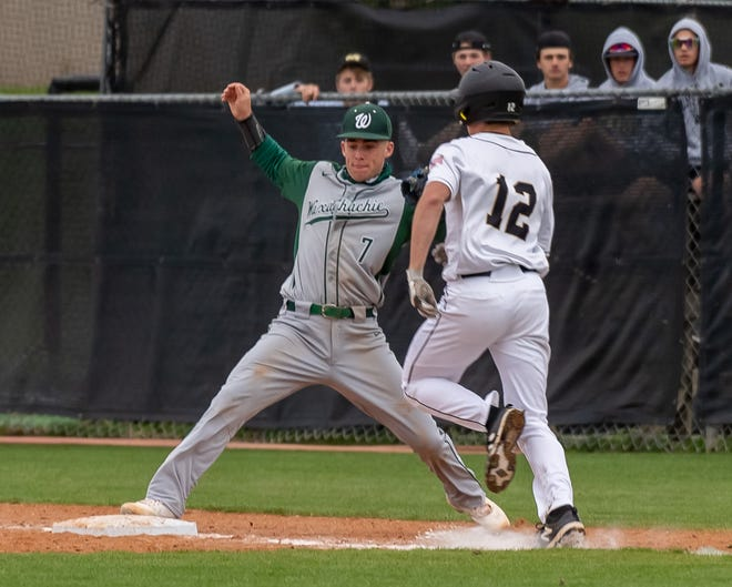 Waxahachie first baseman Cade Davis (7) steps on first base for a putout during Saturday's rescheduled District 11-6A baseball game at Mansfield. The first-place Tigers defeated the Indians, 3-1.