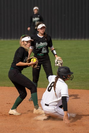 Waxahachie second baseman MaKenna Stone, left, gets a forceout after taking the throw from shortstop Bryten Burns (10) during Saturday's rescheduled District 11-6A softball game at Mansfield.