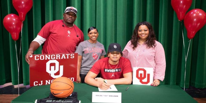 Waxahachie senior CJ Noland signs his national.letter of intent last November to play basketball for the University of Oklahoma. Even though the Sooners have changed head coaches following the retirement of Lon Kruger, Noland has committed to playing for new coach Porter Moser at OU.