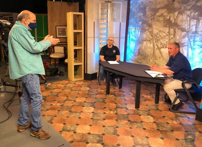 """Mansfield Cable Access Director Jack O'Neil works with Mansfield police Det. Sgt. Dan MacLean and Det. Tony Lattanzio on their new cable show, """"Detective's Corner."""""""