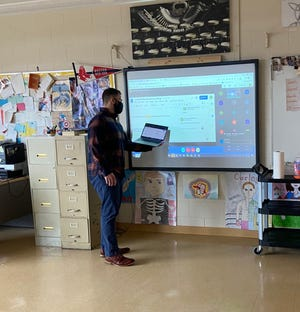 OA English teacher Alexander Schervish teaching both in-person and remote students. Next Monday, students in grades 6-12 will return to full-time, in-person learning.