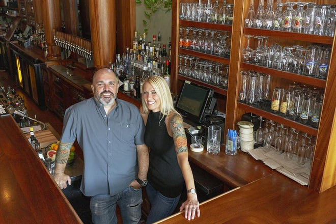 Armsby Abbey owners Alec Lopez and Sherri Sadowski in the restaurant in 2018.