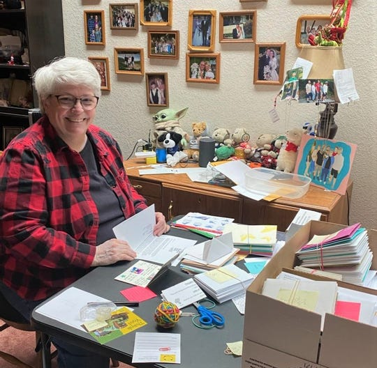The Bremerton School District is using volunteers like Kathy Cates for its Kindness Project, designed to encourage students and staff with personalized letters and cards.
