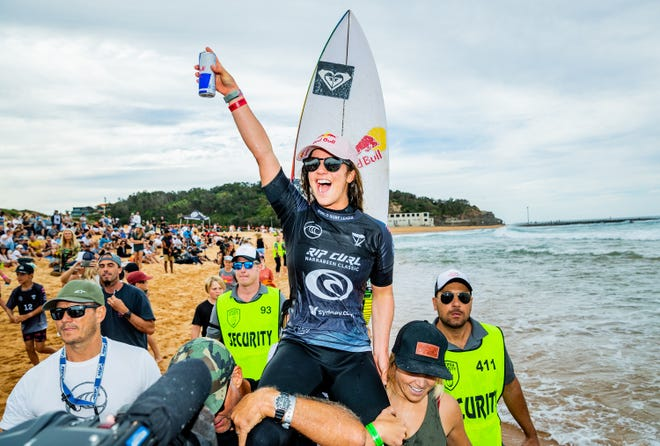Caroline Marks celebrates after winning the Rip Curl Narrabeen Classic on April 20, 2021, in Narrabeen, Australia.