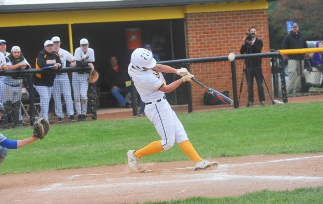Colonel Crawford's Micah Thomas pops a ball up in the infield.