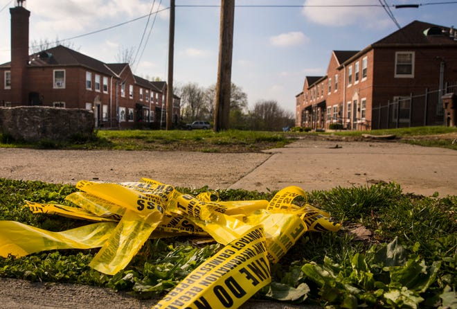 The scene in Winton Terrace where a 13-year old stabbed and killed Nyaira Givens, 13, on the evening of April 19, 2021. The next morning, crime scene tape was left on the ground.
