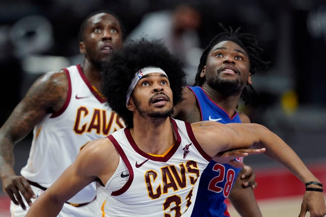 Cavaliers center Jarrett Allen, front, plans to work on his passing during the offseason. [USA TODAY Network]