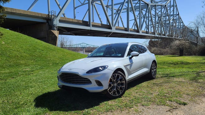 The 2021 Aston Martin DBX is the brand's first SUV, and it is a beaut. Detroit News auto critic Henry Payne took it across the Ohio River to West Virginia.