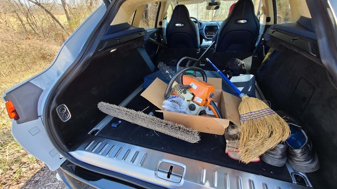 Aston utility. The cargo bay of the 2021 Aston Martin DBX will hold all kinds of useful stuff including a chainsaw and brooms to clear fallen trees.