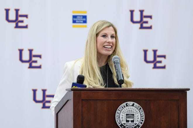 Robyn Scherr-Wells addressees the crowd at the press conference held to formally introduce her as the new University of Evansville women's basketball coach inside UE's Meeks Fieldhouse in Evansville, Ind., Tuesday, April 20, 2021. UE announced Tuesday she's been hired as the eleventh head coach in program history after a month-long search to replace former coach Matt Ruffing.