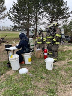 Agents work to dismantle an active meth lab discovered in Green Creek Township Monday.